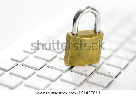 padlock on white keyboard network security conception - stock photo