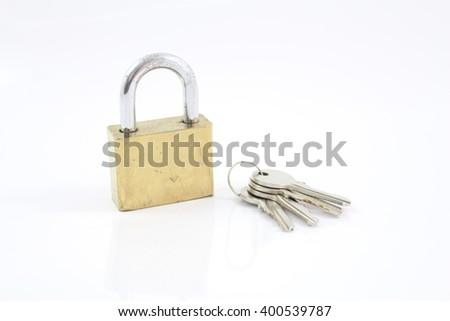 Padlock with key on a white background - stock photo