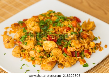Paella serving on a plate. - stock photo