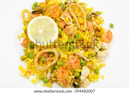 Paella with chicken and seafood, white background,close-up, isolated, top view - stock photo