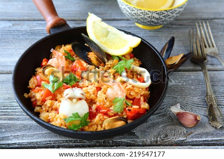 Paella with rice and seafood, delicious food - stock photo