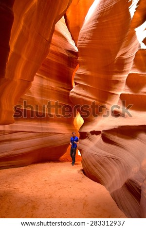 PAGE, AZ - MAY 26: Upper Antelope Canyon tour on May 26, 2015 in Page AZ,USA. Thousands of people from all over the world come to visit Upper Antelope Canyon - stock photo