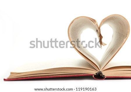 pages of a book curved into  heart - stock photo
