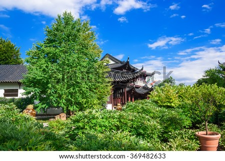 Pagoda in the garden with beautiful by green plants. - stock photo