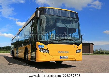 PAIMIO, FINLAND - JULY 19, 2014: Yellow Scania Citywide bus waits for passengers at a bus stop. Scania Citywide is a single-deck city or intercity bus available in low-floor and low-entry versions.  - stock photo