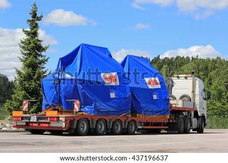 PAIMIO, FINLAND - JUNE 12, 2016: Volvo FH truck is ready to transport two industrial objects on trailer as oversize load in South of Finland.  - stock photo