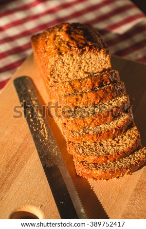 Pain d epices or French Honey Bread, Sliced. Original Homemade Fresh Baked on Wood Board and Knife. Country, Still Life. Close up Selective Shot. - stock photo