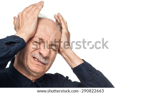 Pain. Elderly man suffering from a headache isolated on white background with copy-space - stock photo