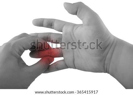 Pain in a finger. holding hand to spot of finger pain. - stock photo