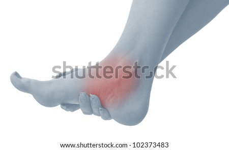 Pain in a woman ankle. Female holding hand to spot of ankle-ache. Concept photo with Color Enhanced blue skin with read spot indicating location of the pain. Isolation on a white background. - stock photo