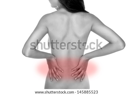Pain in the back, a woman holds her hands lower back - stock photo