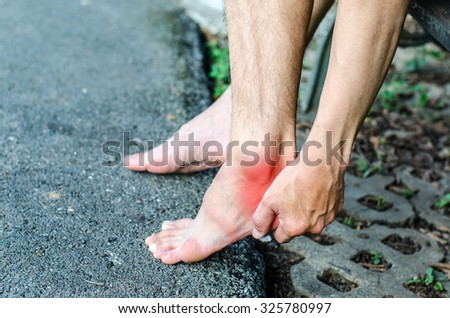 Pain in the foot. Massage of female feet. Pedicures.  - stock photo
