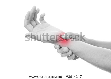 Pain in the joints of the hands. Care of male hands.  Isolated on white background.  Red dot. Black and white photography - stock photo