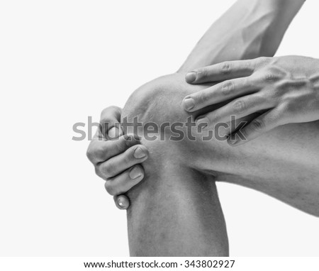 Pain in the knee joint. Monochrome image, isolated on a white background - stock photo