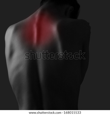 Pain in woman neck on dark background. Injury - stock photo