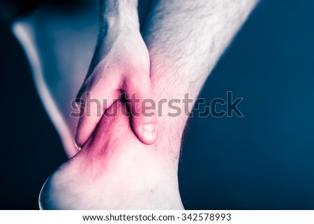 Painful leg and ankle, foot in pain, physical injury. Male leg and muscle pain from illness or accident, running or training, sport physical injuries when working out. Man athlete with painful leg. - stock photo
