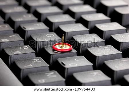 Painful typing, pin on keyboard close-up - stock photo