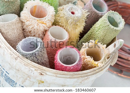 painrollers stacked in a bucket - stock photo