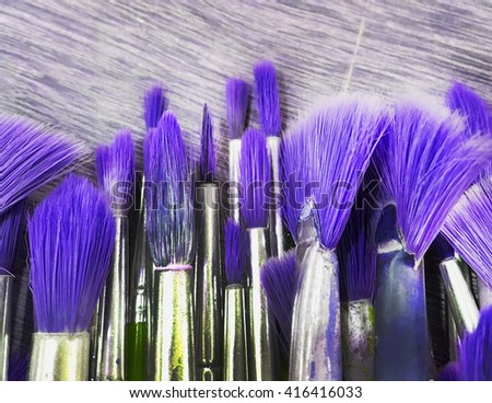 Paint blushes in purple tone - stock photo