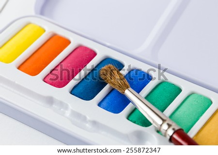 Paint-box, watercolor paints palette, brush - stock photo