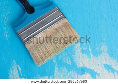 Paint brush on a blue background - stock photo