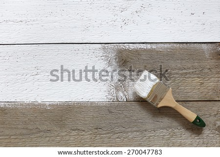 Paint Brush on a Wood Surface, close up - stock photo