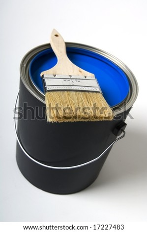 Paint brush on paint can - stock photo