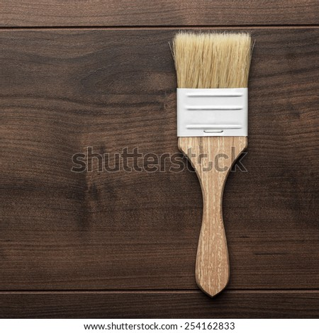 paint brush on the brown wooden table - stock photo