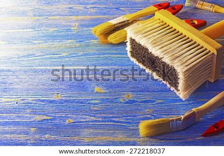 Paint brush on the wooden platform - stock photo