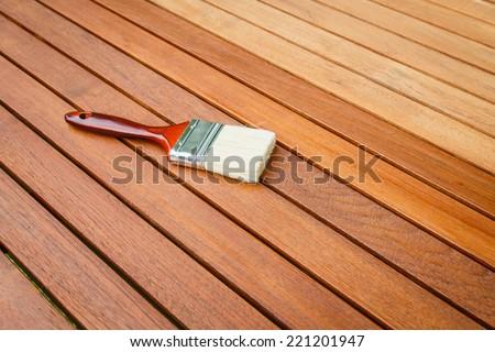 Paint brush on wooden table - stock photo