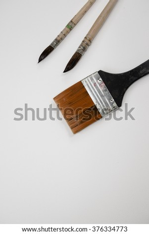 Paint brush or brush dirt on white background watercolor paper. - stock photo