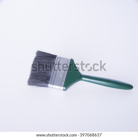 paint brush or green paint brush on a background - stock photo