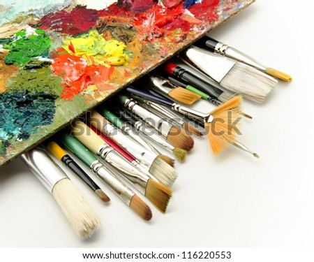 Paint brushes and palette - stock photo