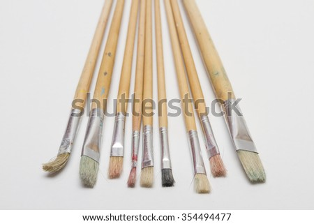 Paint brushes of various sizes on a white background. Classic brush for painting of wood with natural bristles. - stock photo