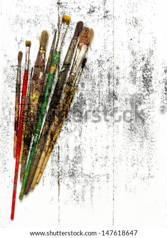Paint brushes on the grunge texture/ Vintage card with old brushe/Arts - stock photo