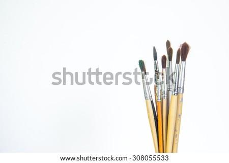 Paint brushes on white background. - stock photo