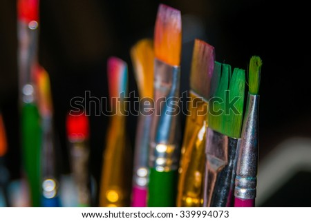 paint brushes. Shallow depth of field - stock photo