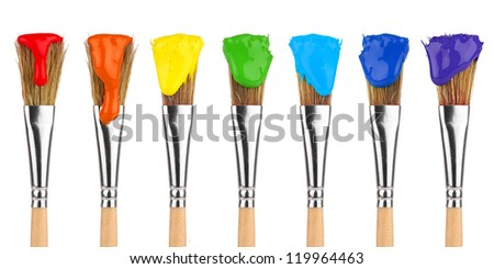 paint brushes with rainbow colors in front of white background - stock photo