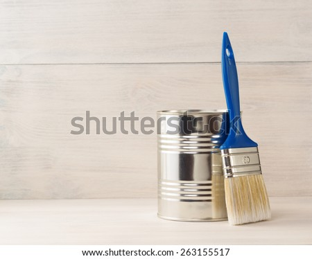 paint bucket and paintbrush  on wooden background - stock photo