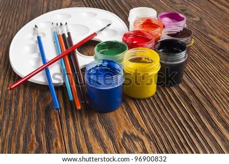 paint buckets and brush - stock photo