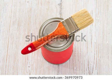 Paint Can Brush on Lid, Red Lacquer White Wood Floor Plank - stock photo