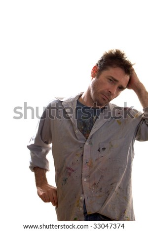 Paint covered home handy man contemplating decorating ideas - stock photo