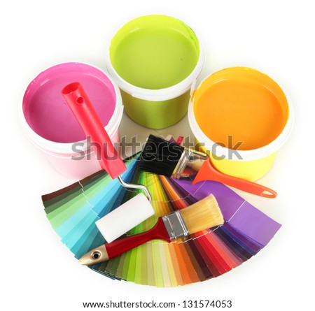 Paint pots, paintbrushes and coloured swatches isolated on white - stock photo