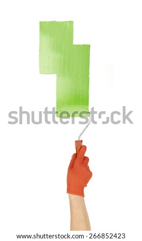 paint roller in hand isolated - stock photo