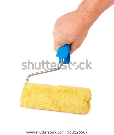 paint roller in hand on a white background - stock photo