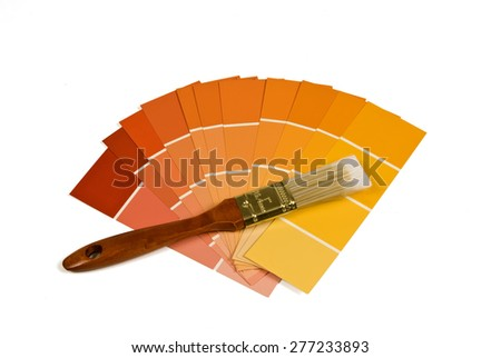 Paint Samples Of Warm Tones With Paint Brush/ Paint Sample And Brush - stock photo