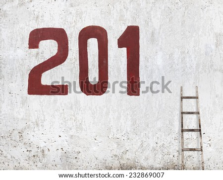 paint the last number of a new year's date, 2015,  painted on the stucco wall - stock photo