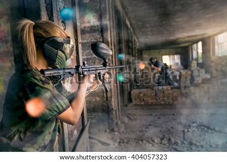 Paintball opposite teams in shootout - stock photo