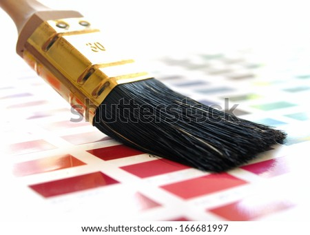 Paintbrush on a color swatch  - stock photo