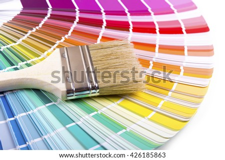 paintbrush on a palette color guide - stock photo